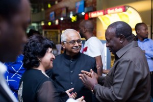 """Minister for Information, Culture, Arts and Sports Dr Harrison Mwakyembe (right) having a chat with Prof. Issa Shivji (centre) and other invited guests at the occasion of the T- junction premier"" 2017"